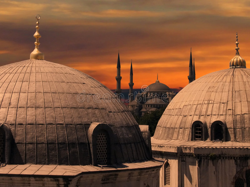 The Blue Mosque in Istanbul. Two domes in front of the Blue Mosque, in Istanbul, Turkey royalty free stock image