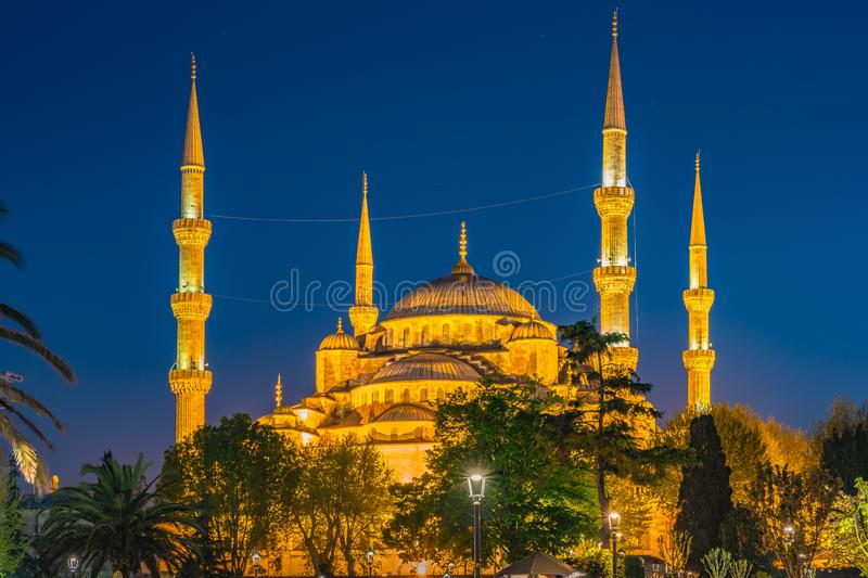 Blue Mosque at night with golden illumination, wide view of Istanbul in dusk. Sultanahmet Camii mosque with six minarets stock images