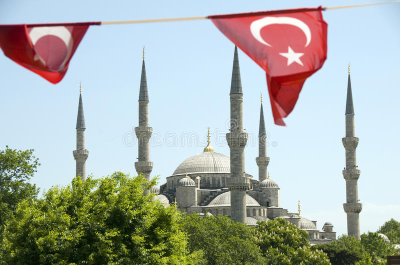 Blue Mosque with Turkish flags Istanbul. Blue Mosque Turkish flags view from M. Arkif Ersoy Sultanahment Park Istanbul Turkey stock photo