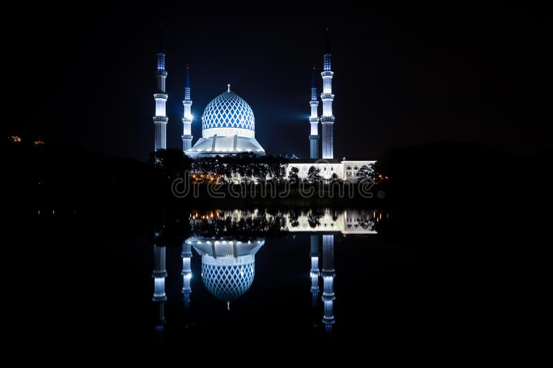 The blue mosque view during night time with reflection in the lake. stock images