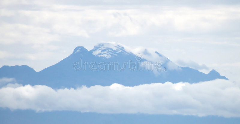 Blue Mountain. Iztaccihuatl, is the third highest mountain in Mexico, is a mere 70 km to the southeast of Mexico City and is often visible from the capital royalty free stock photo