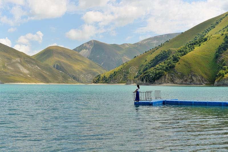 Blue mountain lake Kazenoi Am in the Chechen Republic on a Sunny summer day. royalty free stock image