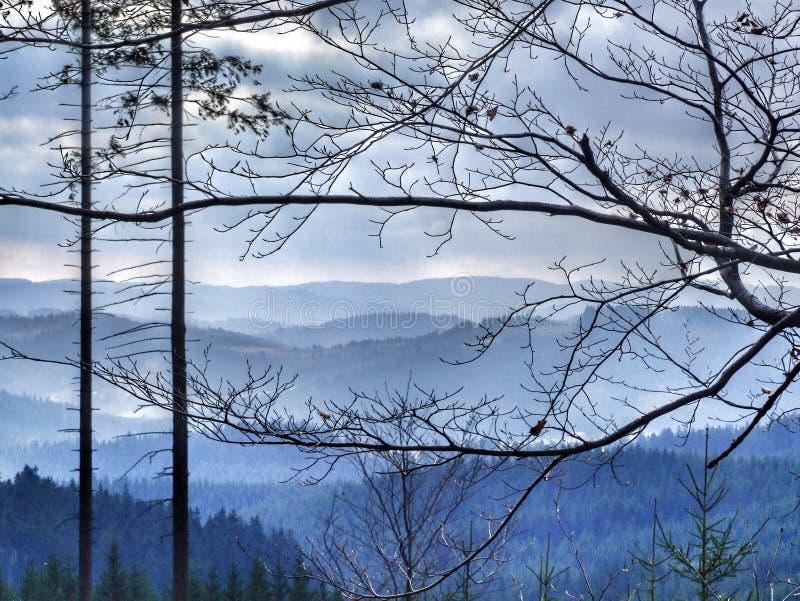 Blue mountain landscape in Moravian-Silesian Beskids in northern Czechia. Winter landscape in Moravian-Silesian Beskids in northern Czechia. Photo taken near stock photography