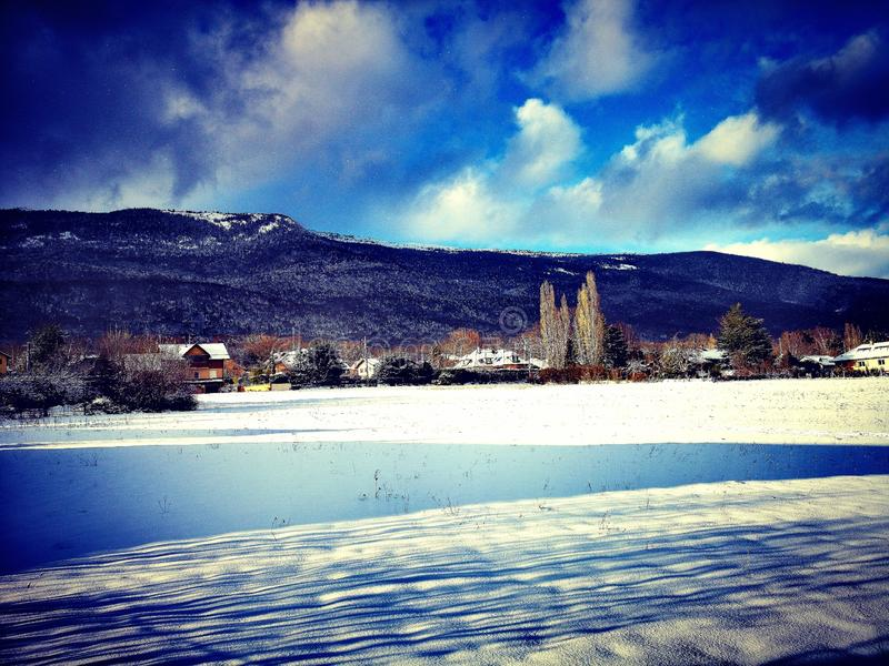 Blue mountain landscape in winter stock images