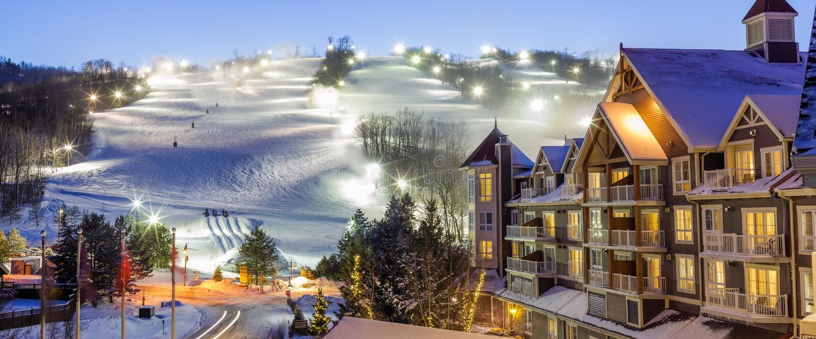Blue Mountain Village in winter. With mountain background stock photography