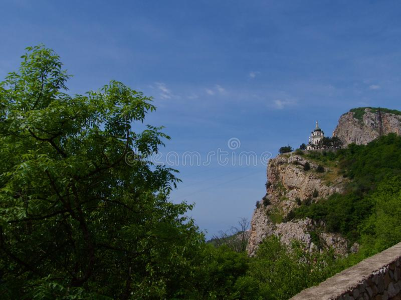 Blue mountains and blue sea. Black Sea Crimea, Church of the Resurrection in Foros. stock photography