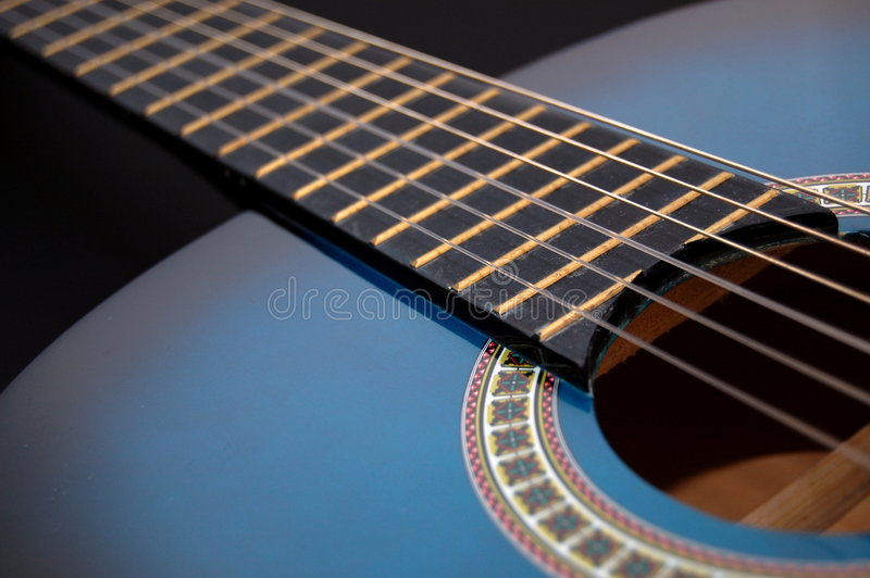 Blue music guitar for playing party music stock photography
