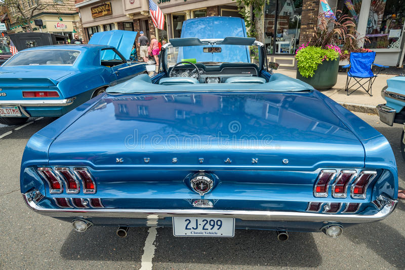 Blue Mustang at car show stock image