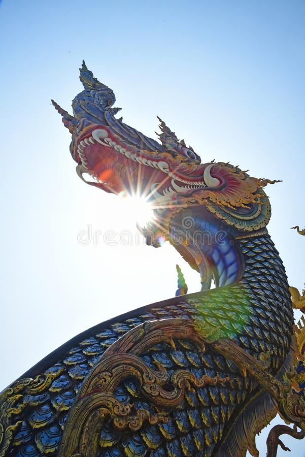 Blue naga statue in buddhism temple thailand stock photo