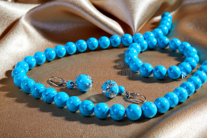Download Blue Necklace And Earrings On A Brown Stock Photo - Image: 25649632