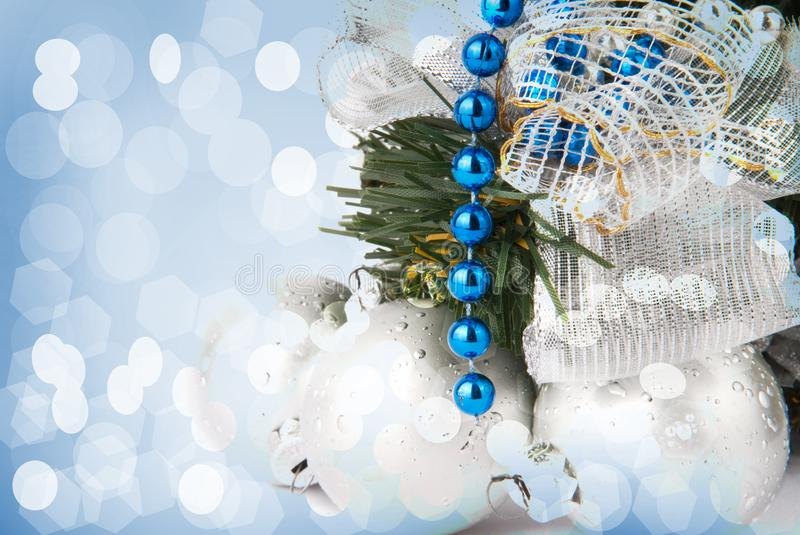 New Year`s background with a Christmas tree and fur-tree toys royalty free stock photography