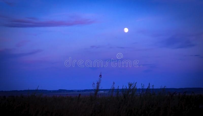 Blue night with moon. Abstract fotografija blue night with Moon stock image