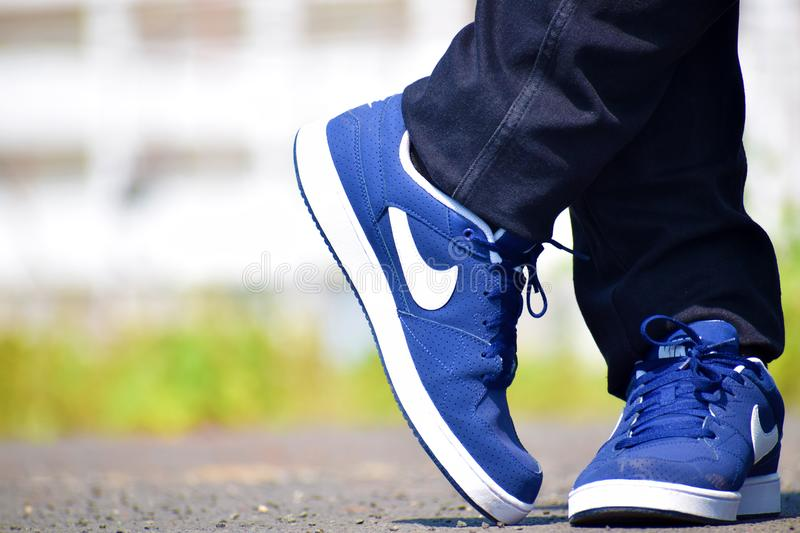Blue Nike Low-top Shoes royalty free stock photo