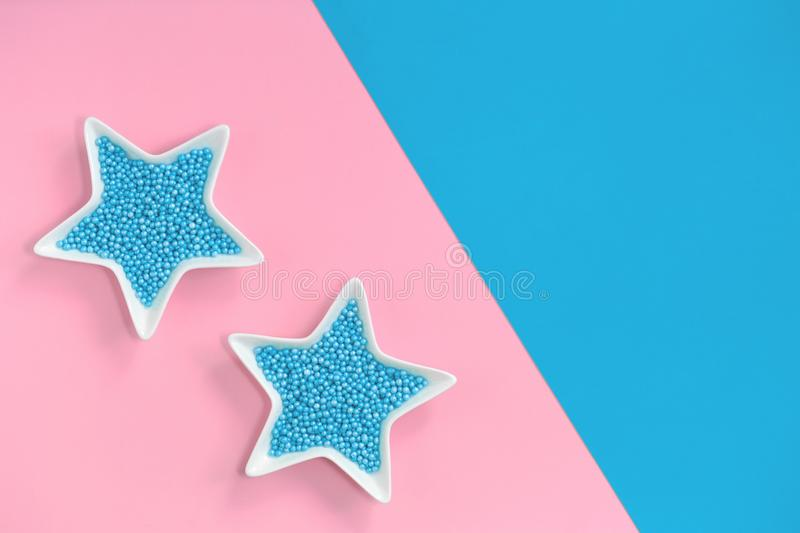 Blue nonpareils cake sprinkles in star bowls royalty free stock photos