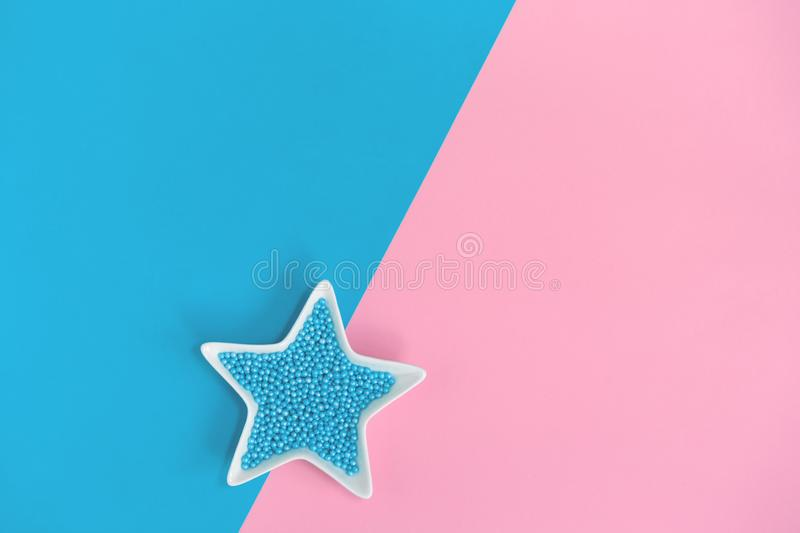 Blue nonpareils cake sprinkles in star bowls royalty free stock photography