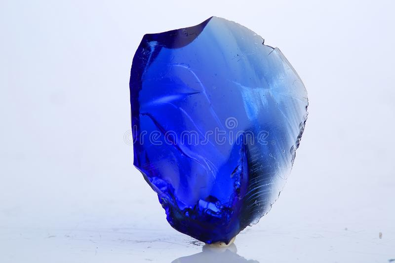Blue obsidian mineral stone specimen rock. Mineral crystal specimens stock photo