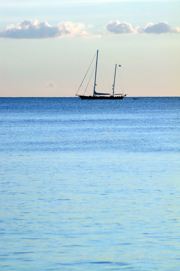 Blue ocean and boat royalty free stock images