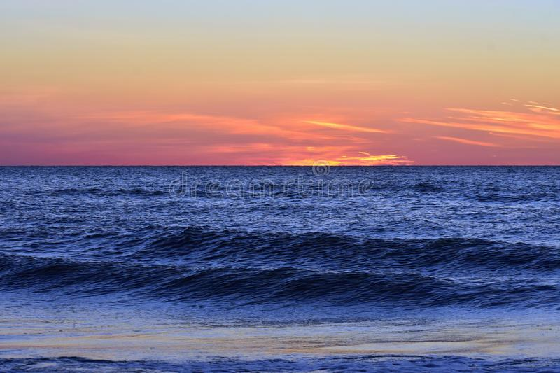Blue ocean on colorful sunset background at Clearwater Beach. Clearwater, Florida. October 21,2018 Blue ocean on colorful sunset background at Clearwater Beach stock photos
