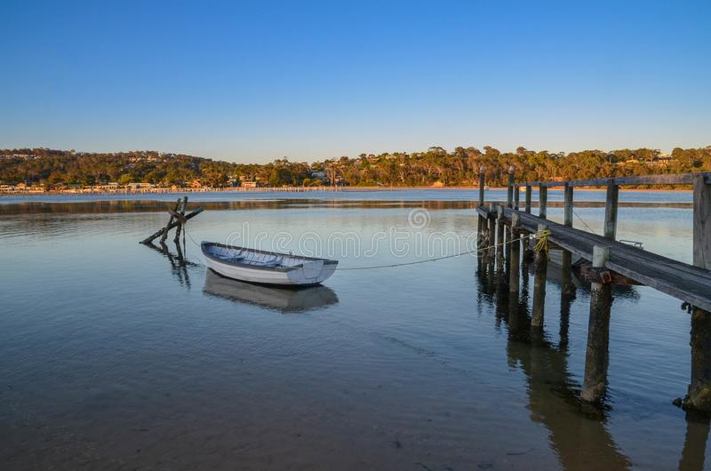 Blue Ocean and a Resting Dinghy at Merimbula on a summer day. Blue Ocean and a Resting dinghy at Merimbula New South Wales Australia n on a summer day royalty free stock photos