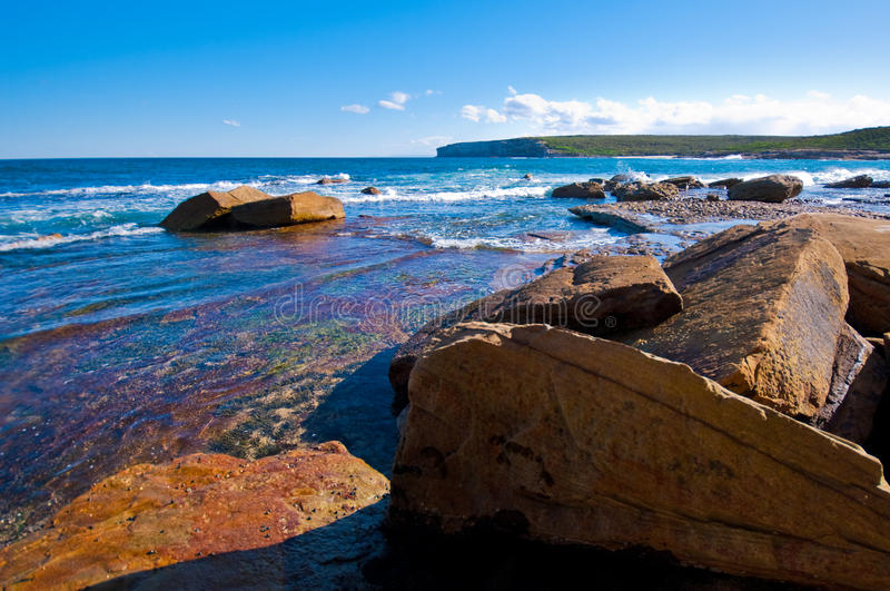 Blue ocean with rocks royalty free stock photography