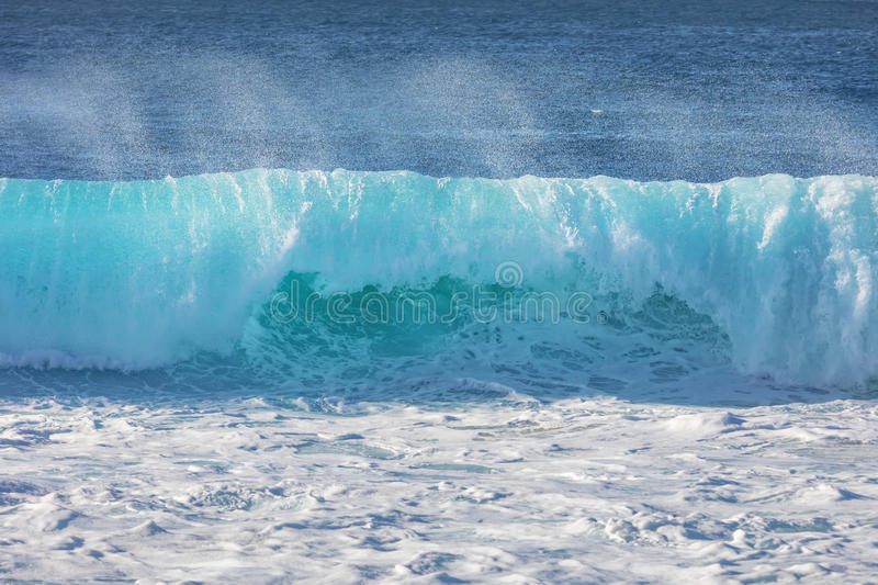 Blue ocean shorebreak wave front view. Blue ocean shorebreak wave for surfing sport activity. Template with nobody on background. Tropical summer scenery stock images