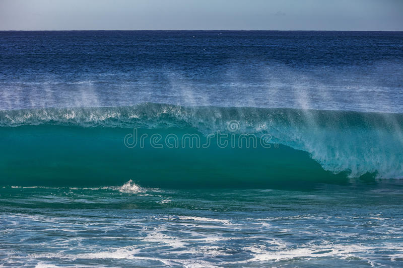 Blue ocean shorebreak wave front view. Blue ocean shorebreak wave for surfing sport activity. Template with nobody on background. Tropical summer scenery stock photo