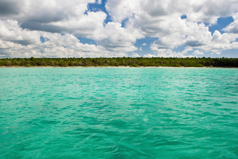 Blue Ocean Before Stone Sand Beach Royalty Free Stock Photos