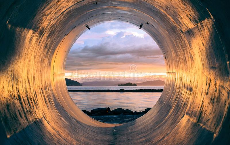 Blue Ocean Water During Sunset Through Round Hole Free Public Domain Cc0 Image