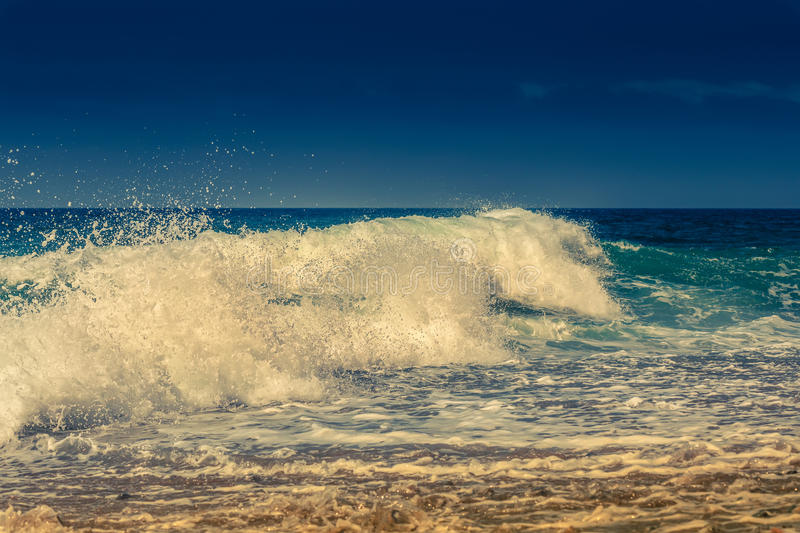 Blue Ocean Wave with spray stock photography