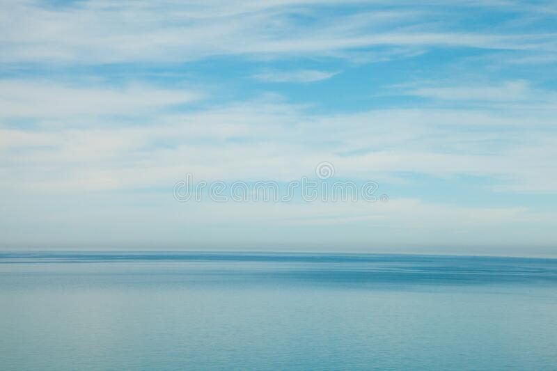 Ocean waves and sky clouds summer background. Blue ocean waves and sky clouds summer background royalty free stock image