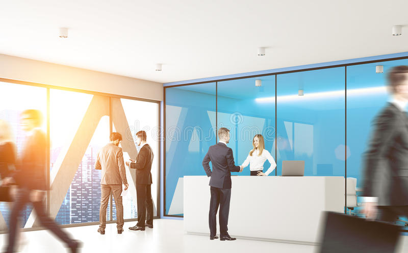 Blue office with people. Businesspeople are passing by a reception counter in an office with blue walls. 3d rendering, toned image royalty free stock photos
