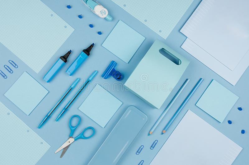 Blue office stationery collection on soft pastel blue paper background, top view. Blue office stationery collection on soft pastel blue paper background, top royalty free stock image