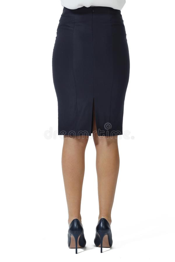 Blue official midi skirt and stiletto heels shoes close up photo on model. Isolated on white stock photography
