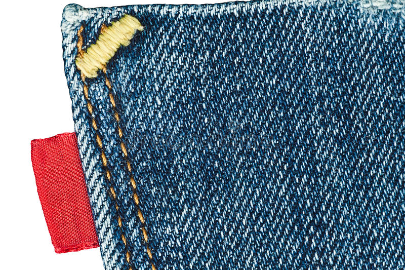 Blue Old Jeans Pocket With Empty Red Label Royalty Free Stock Images