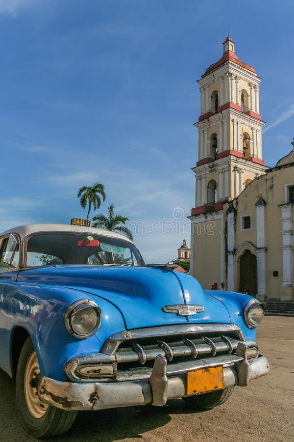 Blue classic Chevrolet parked in the central square in Remedios. Cuba stock photography