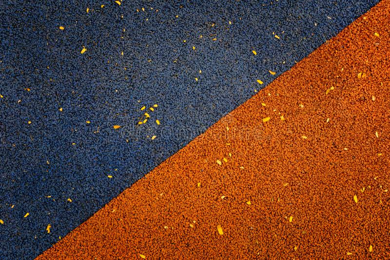 Blue and orange color of Rubber flooring Play park flooring back stock photo
