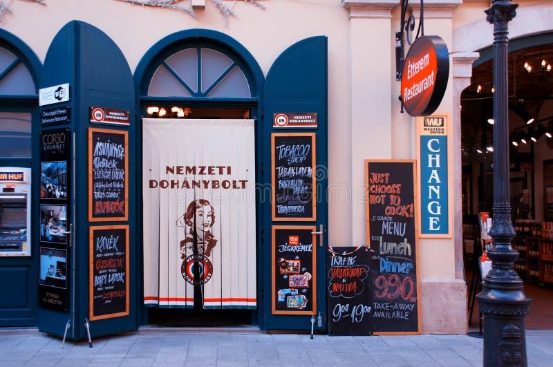 Blue and Orange Nemzeti Dohanybolt Commercial Store royalty free stock image