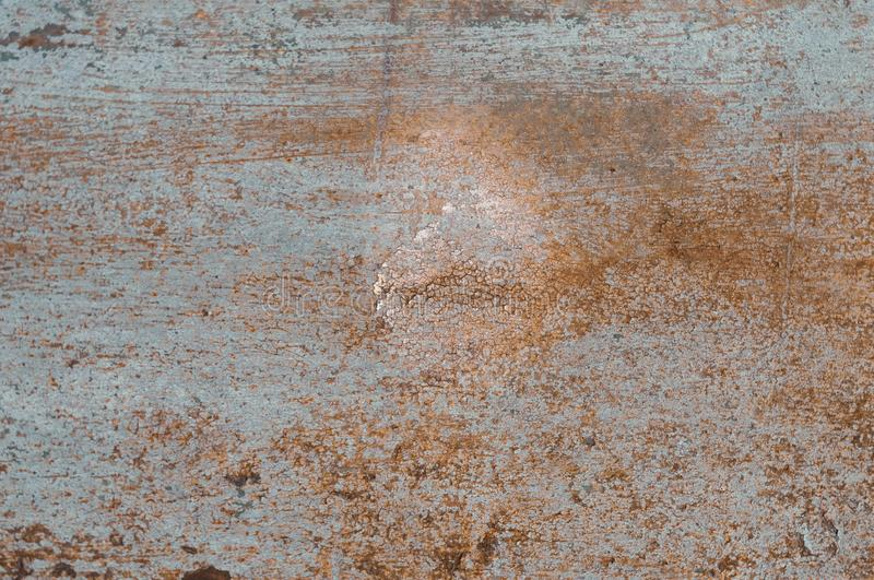 Blue and orange painted scratched and cracks rusty grunde textured surface. For background, banner and copy space stock image