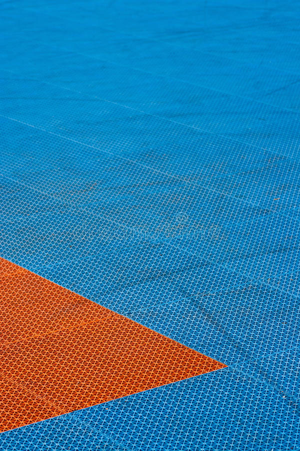 Download Blue And Orange Plastic Texture Playground With Trails On It. Stock Photo - Image: 47595482