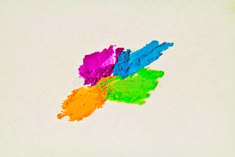 Blue, orange, purple green pastel artists chalk powder. royalty free stock image
