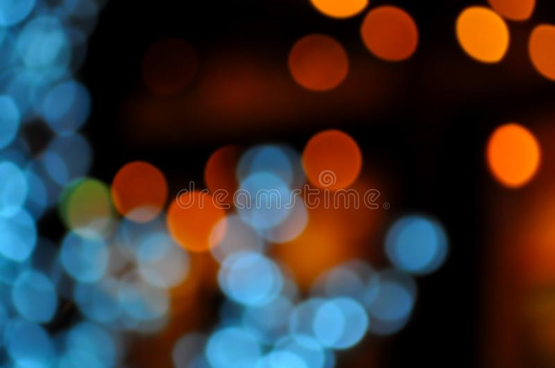Blue,orange,red and dark abstract light background, Colorful bokeh,circle shining lights, sparkling glittering Christmas,New year. Lights. Blurred abstract royalty free stock photos