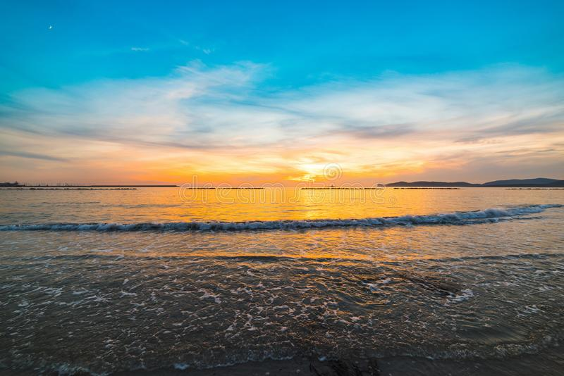 Blue and orange sky over the sea in Alghero. At sunset. Sardinia, Italy stock images