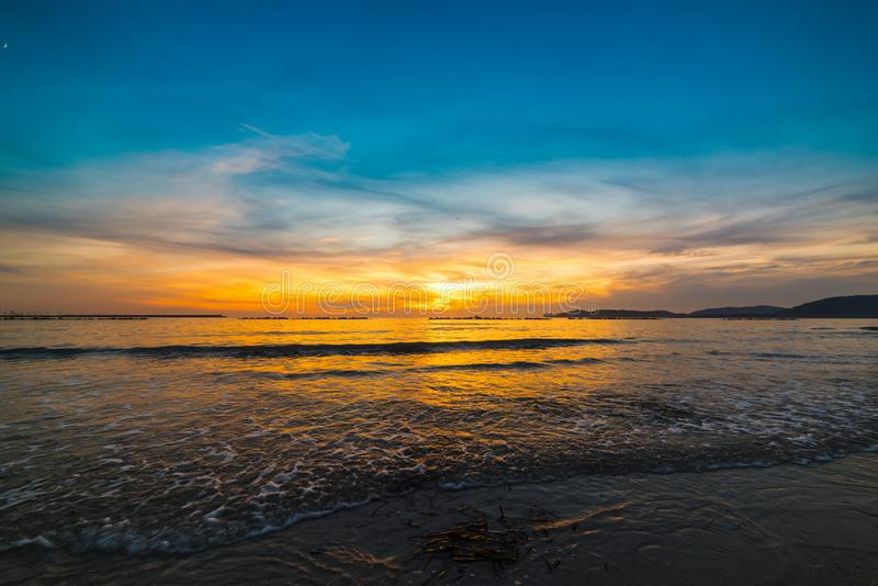 Blue and orange sky over the sea in Alghero at sunset. Sardinia, Italy stock images