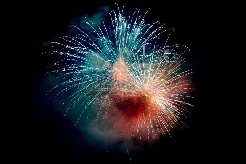 Blue Orange Sparkling Fireworks Background op Night Scene royalty-vrije stock afbeelding