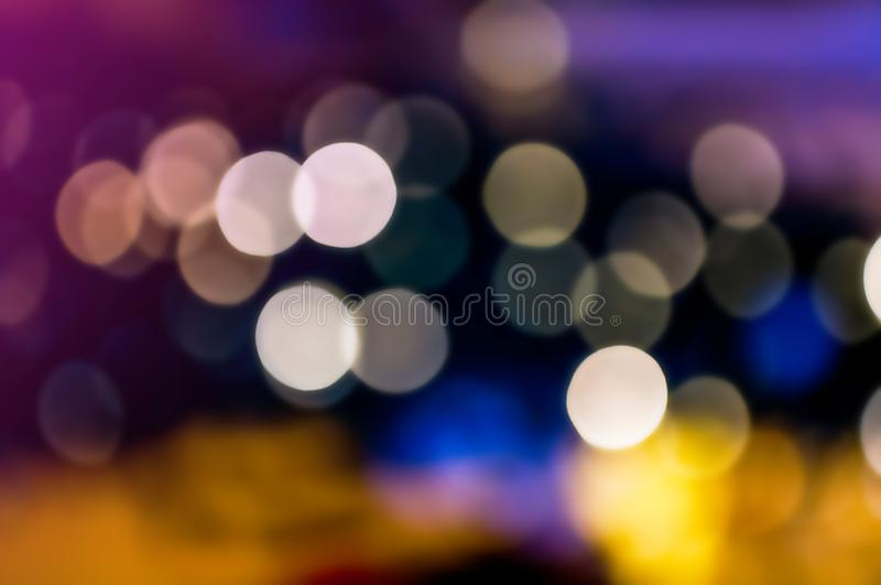 Blue,orange,ultra violet,purple and pink abstract night light background,Colorful bokeh,circle shining lights, sparkling glitterin royalty free stock image