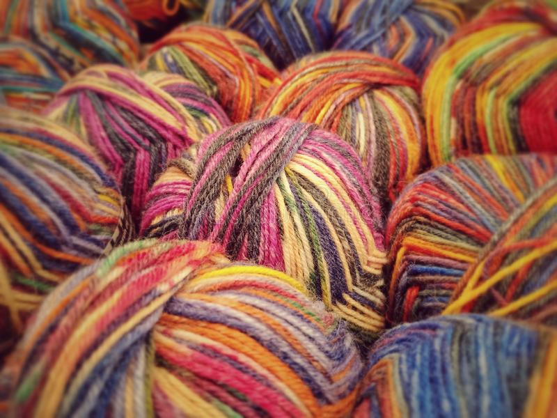 Colorful yarn on sell in shop. Blue, orange and various multicolored wool yarn on sale abstract art background ball bright clew closeup colorful coloured cotton royalty free stock photo