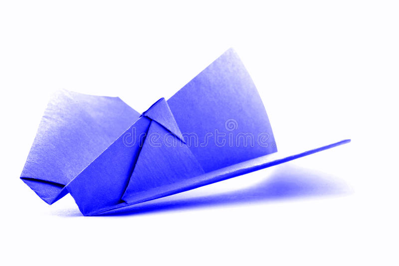 Blue origami airplane, paper handmade plane isolated on white background stock images