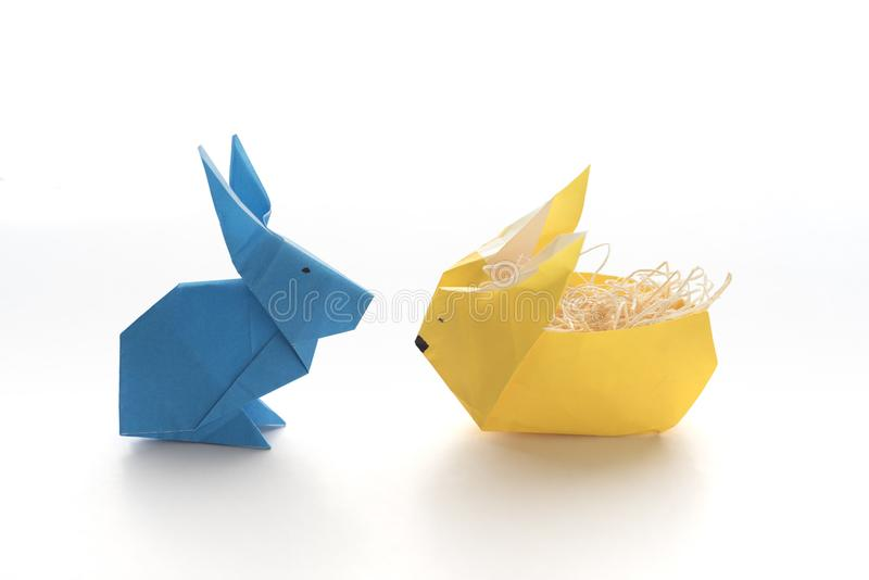 Blue Origami Rabbit Yellow Origami Rabbit for Easter royalty free stock images