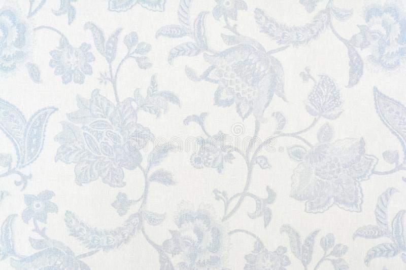 Blue ornate floral pattern on white cotton tablecloth. royalty free stock photo