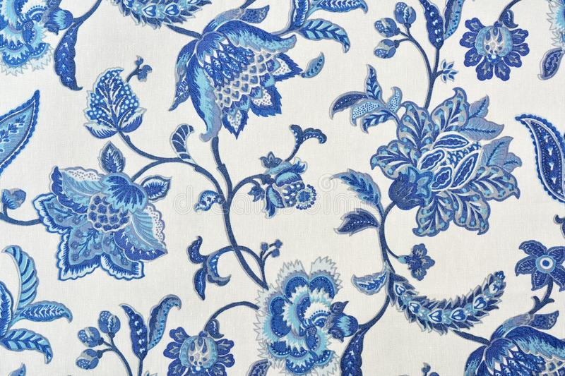 Blue ornate floral pattern on white cotton tablecloth. stock photos